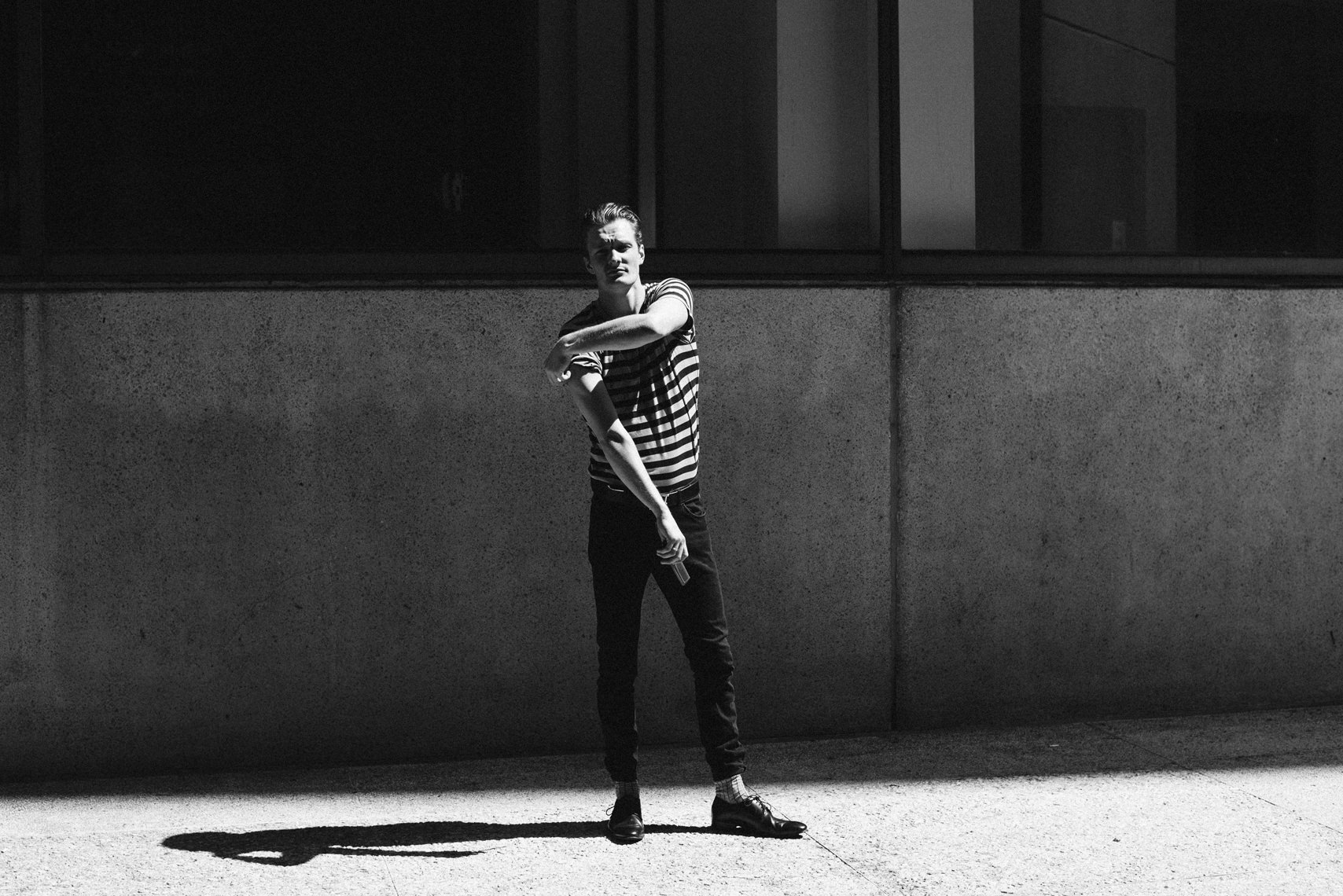 Black and white creative photoshoot in downtown Vancouver with male model.